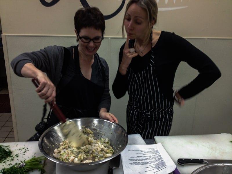 Andi working in the Ramekins Culinary School kitchen