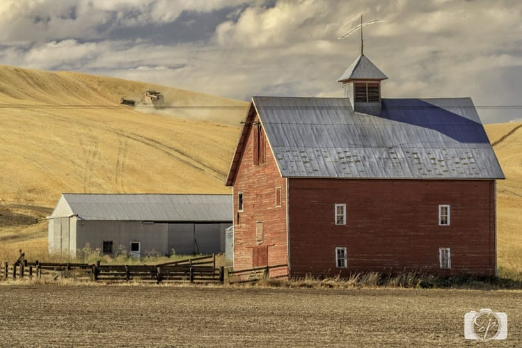 Palouse red barn and harvester
